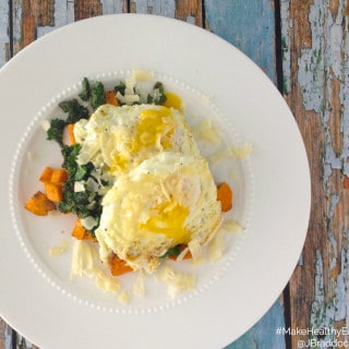 This is a quick and delicious gluten free meal, perfect for breakfast, lunch or dinner. Combining sweet potatoes with savory cheddar, a runny egg and charred kale packs a flavor and nutritional punch that will have you craving more. #MakeHealthyEasy via @JBraddockRD www.JennaBraddock.com