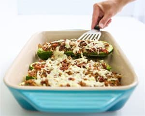 Sausage & Quinoa Stuffed Zucchini: Sun-dried tomatoes, lean sausage and Cabot cheddar jazz up the quinoa based filling for this delicious stuffed zucchini dish. It will have even quinoa-haters thinking twice. #MakeHealthyEasy