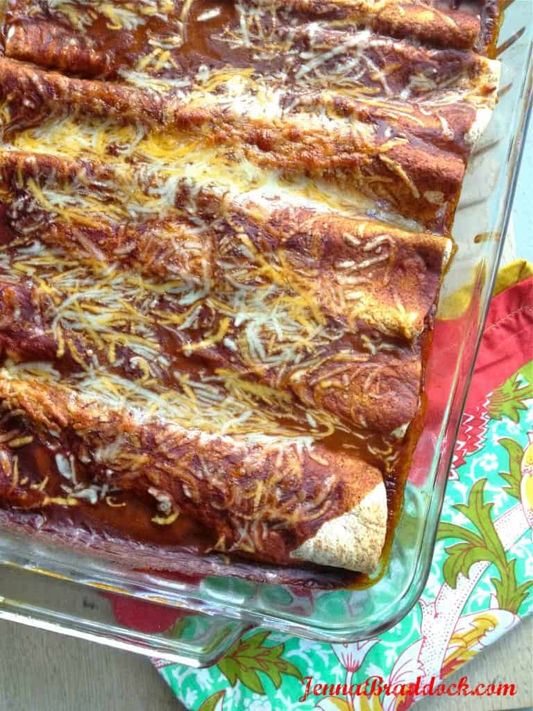 These All Natural, Easy Chicken Enchiladas are a great way to use up leftover chicken but transform it in to a healthy meal that will WOW everyone. There's nothing better than a warm, cheesy meal that's also good for you! #MakeHealthyEasy | @JBraddockRD