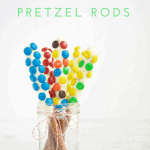These White Chocolate Dipped Pretzel Rods are so easy that you will never need to buy a sweet treat for a party or special gift again. Serve them open in a mason jar or individually wrapped for a reasonable, beautiful dessert. #MakeHealthyEasy via @JBraddockRD http://JennaBraddock.com