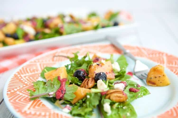 A tutorial on how to slice and grill cantaloupe that finishes with the recipe for Grilled Cantaloupe Salad with Blueberry Ginger Vinaigrette. #MakeHealthyEasy via @JBraddockRD https://jennabraddock.com