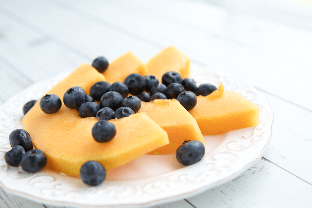 A tutorial on how to slice and grill cantaloupe that finishes with the recipe for Grilled Cantaloupe Salad with Blueberry Ginger Vinaigrette. #MakeHealthyEasy via @JBraddockRD http://jennabraddock.com