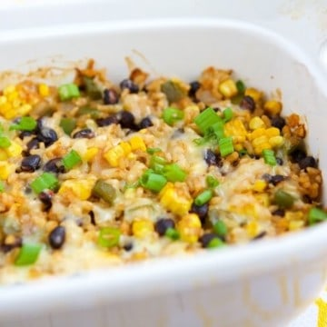 This Vegetarian Rice & Bean Casserole is an easy and healthy solution for getting dinner on the table. It can be made ahead and frozen so it's extremely quick to throw together. #MakeHealthyEasy via @JBraddockRD http://JennaBraddock.com