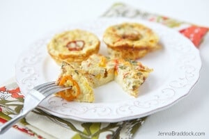 This lightened up version of quiche is packed with huge flavor from roasted garlic and tomatoes. Roasted Garlic & Tomato Mini Crustless Quiche are perfect for a healthy, anything-but-boring breakfast or a special occasion brunch. #MakeHealthyEasy via @JBraddockRD http://JennaBraddock.com