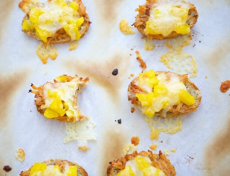 This Mango Cheddar Pork Crostini is an easy, delicious appetizer that's on the lighter side. But don't worry, no one will notice because they taste so good.