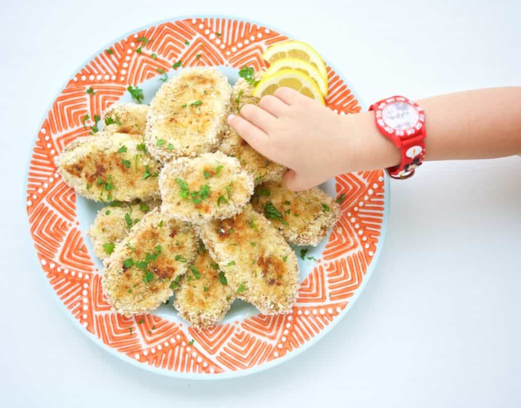 This Homemade Fish Fingers recipe will become a staple in your home in no time and help you reach the recommendation of eating seafood twice a week for a healthy heart. It's kid friendly and customizable to your taste preferences. Little fingers will gobble up these fish fingers!