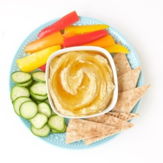 Take hummus up a notch with this fancy, but simple, honey drizzled roasted garlic hummus recipe.