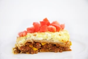 This hearty Healthy Mexican Lasagna recipe is sure to become a regular for your family. Make it in a disposable pan and it becomes a great recipe to make when bringing dinner to a friend (but no judgement if you make it in a disposable pan for yourself.)