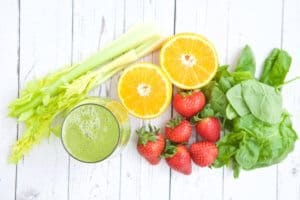 In my humble opinion, a good smoothie recipe is one of the BEST ways to quickly, easily and usually deliciously to add more fruits and vegetables to your life. This Strawberry Orange Green Smoothie recipe is one of my go-to recipes for my daily smoothie.