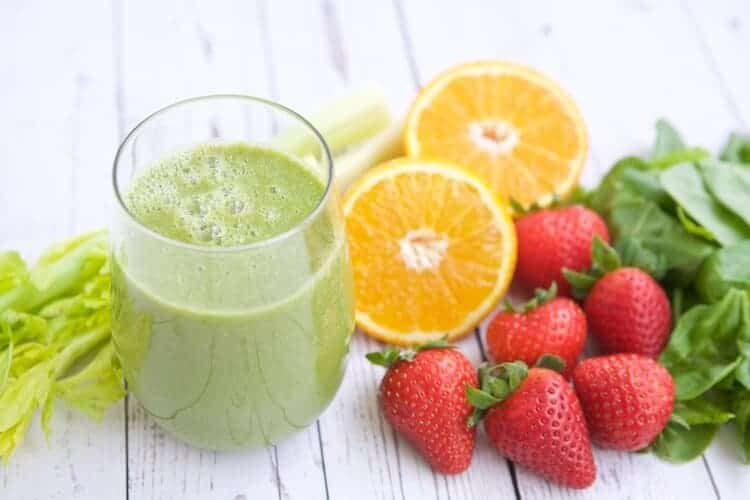 In my humble opinion, a good smoothie recipe is one of the BEST ways to quickly, easily and usually deliciously (is that a word?) to add more fruits and vegetables to your life. This Strawberry Orange Kale Smoothie recipe is one of my go-to recipes for my daily smoothie.