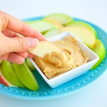 """This simple 3 ingredient Peanut Butter Frosting Dip is so good you won't believe it's healthy. It's perfect for dipping all kinds of fruit and other """"dippers."""""""
