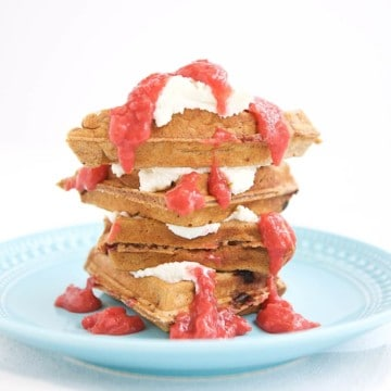 This whole grain strawberry waffle with strawberry sauce is everything you are looking for in a healthier waffle, and more! The simple strawberry sauce is a divine topping, allowing you to forgo syrup and not miss it.