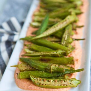 Elevate your appetizer or side dish scene with this sophisticated, yet simple to prepare, Roasted Okra with Smoky Red Pepper Ricotta recipe.
