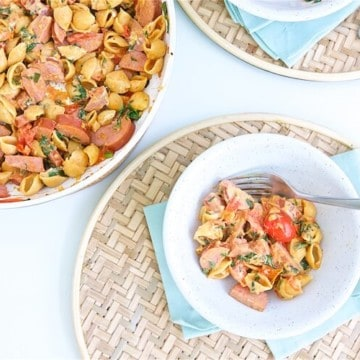 Creamy Tomato Kielbasa Pasta is a quick and balanced dinner recipe perfect for busy weeknights. This could become your family's next favorite meal.