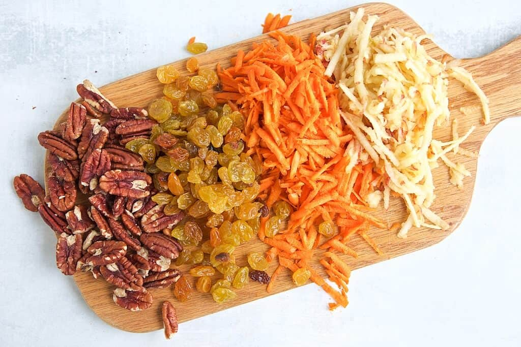 Pecan, raisins, shredded carrots and shredded apples