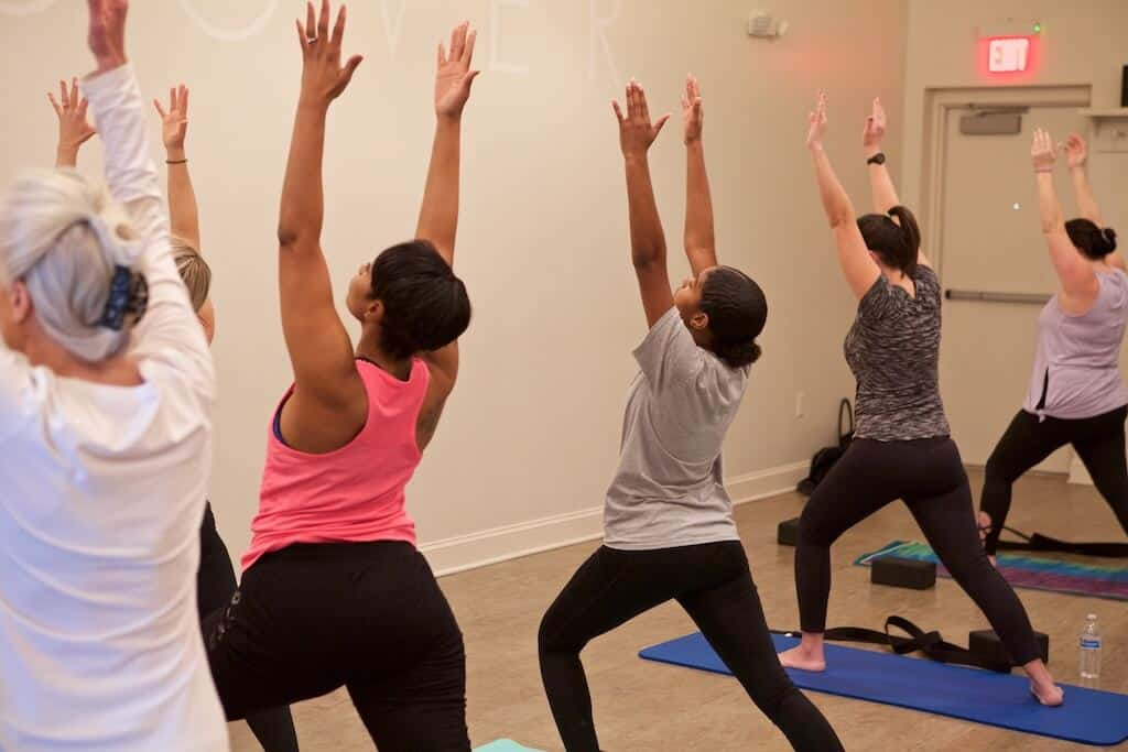 women's wellness - women doing yoga