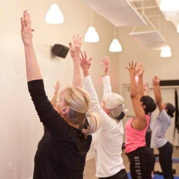 women's wellness - women doing yoga