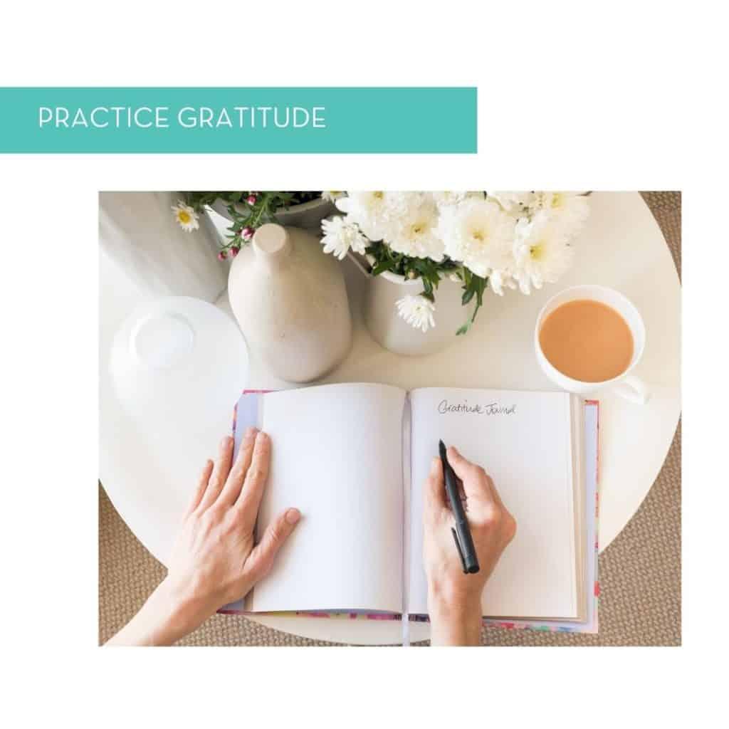 Hands journaling a gratitude list