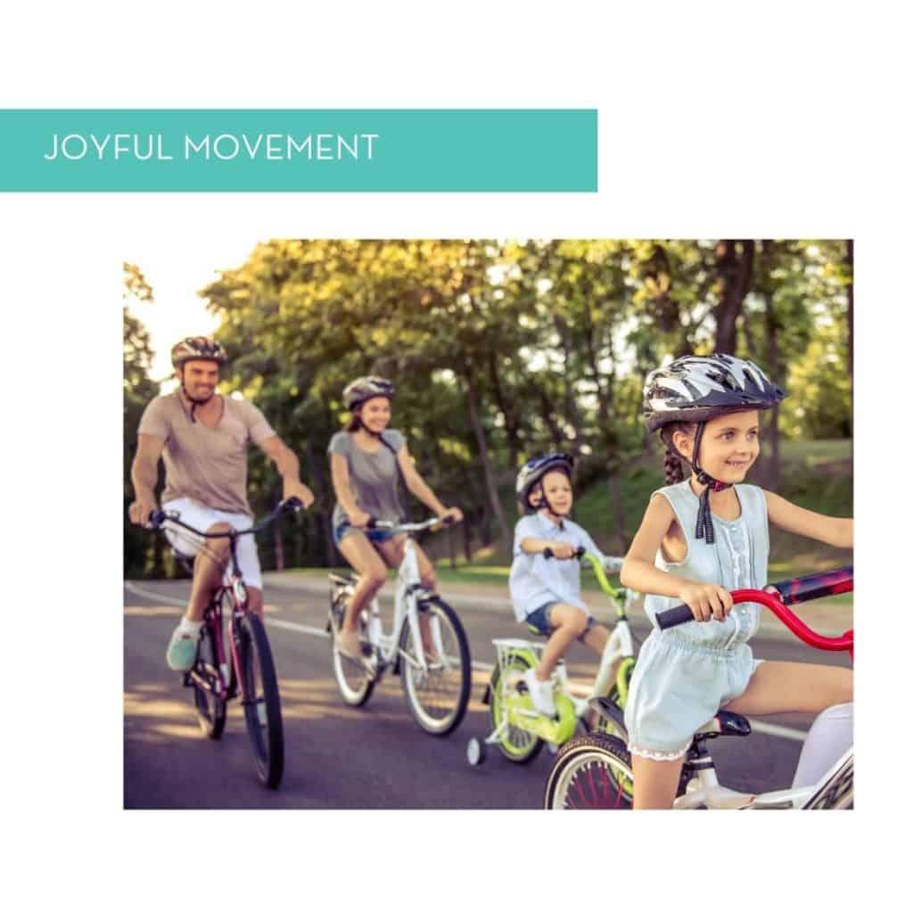 Family bike riding for joyful movement