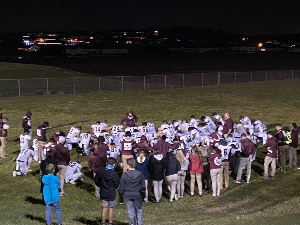 the end of the season - football team huddle after game