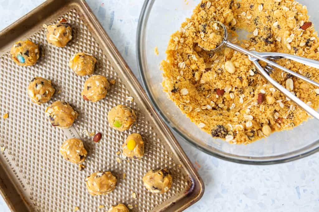 gluten free monster cookie balls scooping into balls